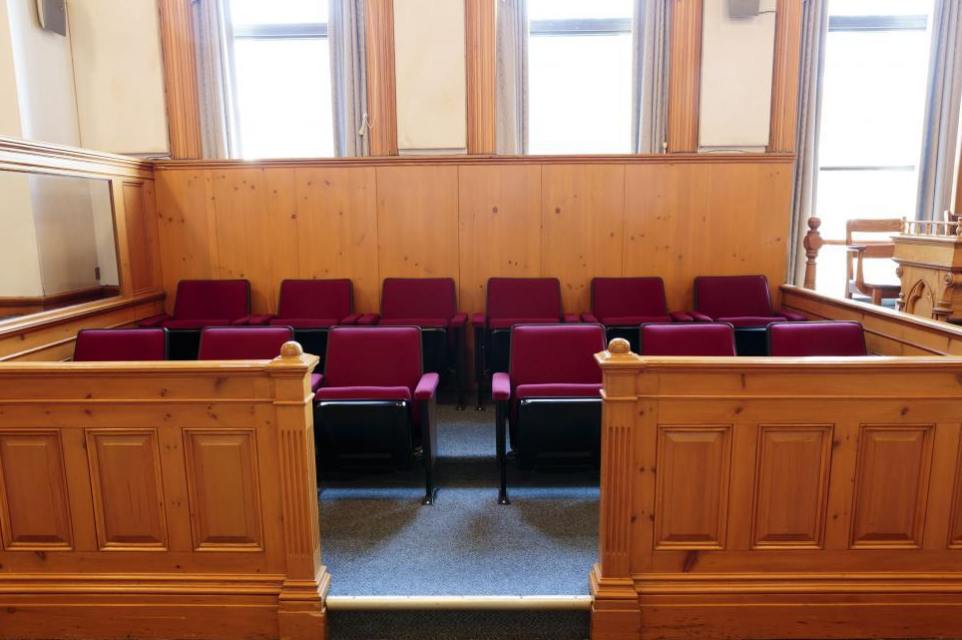 Empty jury seating box in court room